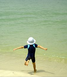 Free Boy Running Into Water Royalty Free Stock Photos - 2219128