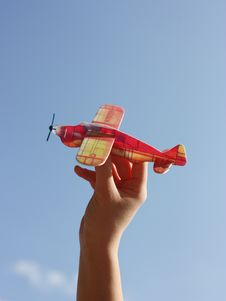 Free Young Hand Holding A Toy Plane Stock Photos - 22106563