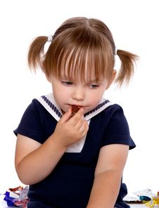 Free The Little Girl Eats A Chocolate Royalty Free Stock Photography - 22111727
