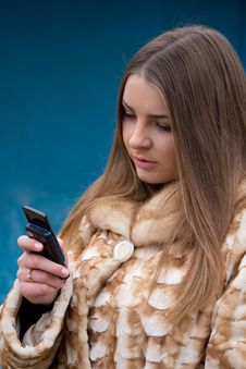 Free Girl With Phone Royalty Free Stock Photo - 22115765