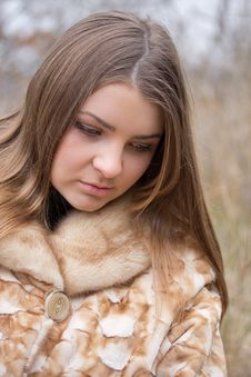 Free Young Woman In A Fur Coat Stock Photography - 22115892
