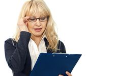 Woman Thoughtfully Read The Documents Stock Images