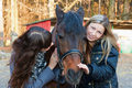Free Two Girls Playing With Horse Stock Photo - 22121350