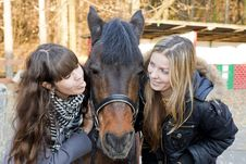 Free Two Girls Playing With Horse Royalty Free Stock Image - 22122106