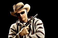 Free Caucasian Man In Mexican Clothes Holding Handgun Royalty Free Stock Photography - 22124357