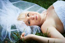 Free Portrait Beautiful Bride Lying On Grass Stock Photography - 22124802