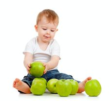 Adorable Child With Green Apples Stock Image
