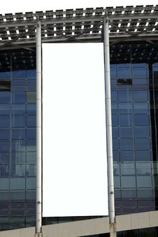 Hanging Blank Billboard On Glass Curtain Wall Royalty Free Stock Photo