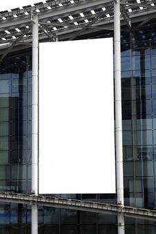 Hanging Blank Billboard On Glass Curtain Wall Royalty Free Stock Photography