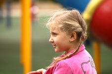 Free Girl Riding On A Swing Watching Stock Images - 22133304