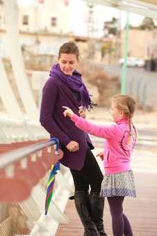 Free Mother And Daughter Walking On The Bridge Royalty Free Stock Photography - 22135587