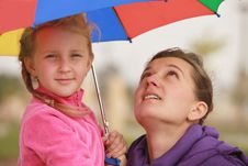 Free Girl And Mom  Umbrella Of Color Royalty Free Stock Photography - 22135617