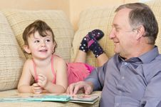 Free Grandfather Reading With Grandniece Stock Images - 22135884