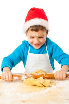 Smiling Little Bot Kneading For Christmas Cooking Stock Image