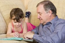 Free Grandfather Reading With Granddaughter Royalty Free Stock Image - 22161906