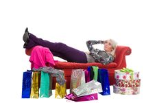Woman Lying On A Red Couch, Shopping Bags Stock Images
