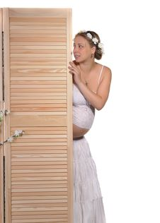 Free Pregnant Woman Peeks Out From Behind The Screen Royalty Free Stock Image - 22167616
