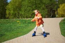 Free Girl Rides On Roller Skates Royalty Free Stock Photo - 22169385