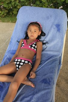 Free Chinese Girl On Lounge Chair Stock Photos - 22175423