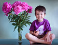 Free Portrait Of A Cute Boy With Peonies Royalty Free Stock Photos - 22187258