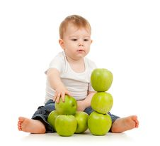 Adorable Child With Green Apples Stock Photography