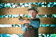 Free Portrait Of A Cute Boy Playing With A Pistol Stock Image - 22187181