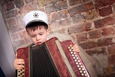Free Cute Boy Playing On Accordion Stock Photography - 22187662