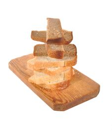 Free Pieces Of Bread  On A Wooden Board Stock Photography - 22187902