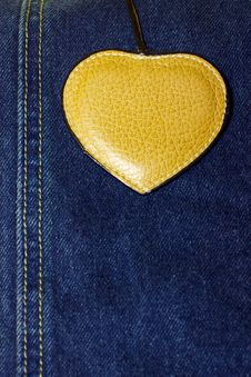 Free Brown Leather Heart On Blue Jeans Background Stock Photography - 22189912