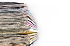 Pile Of Magazines On White Background Royalty Free Stock Photography