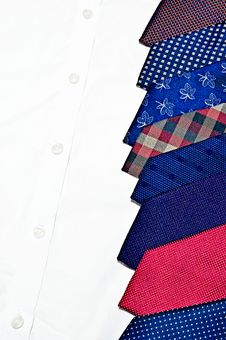 Free Colorful Neck Ties On White Buttoned Shirt Royalty Free Stock Image - 22191066