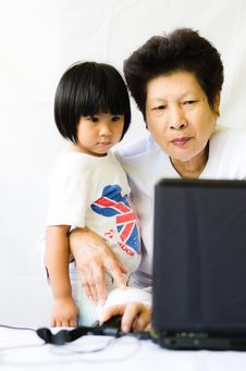 Old Woman With Girl Using Laptop Computer Royalty Free Stock Images