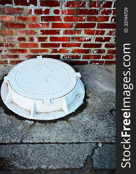 The white manhole. vertically