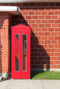 Free Red Phone Booth And Brick Wall Royalty Free Stock Photo - 2229775