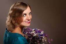 Free Smiling Woman With Flowers Royalty Free Stock Images - 22200889
