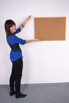 Free Happy Woman With Blank Pin Board. Stock Image - 22213371