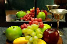 Free Fruit Tray, Silver Wine Glass With Reflection Through Mirrored Window Stock Image - 222117841