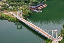Free Bridge Across A Calm Lake Royalty Free Stock Images - 22224209