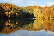 Free Hills Of Autumn Colors Reflected In A Calm Lake Stock Image - 22233481