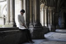 Free Woman Meditating In The Cloister Stock Image - 22234631