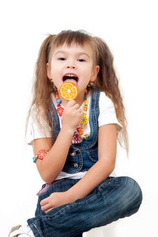 Free Cute Happy Little Girls Tasting Brigh Lollipop Royalty Free Stock Photography - 22239497