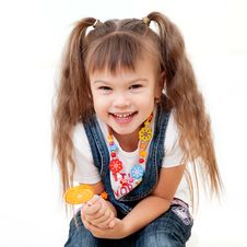 Free Laughing Pretty Girl With Lollipop Royalty Free Stock Images - 22239509