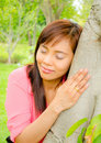 Free Girl Close Her Eyes And Listen Sound From A Tree Stock Photography - 22240312