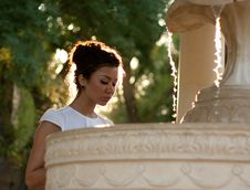 Brunette Near The Fountain Stock Photography
