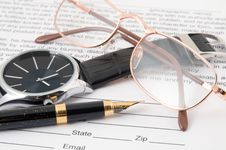 Free Eyeglasses And Pen And Wristwatch Stock Image - 22248801