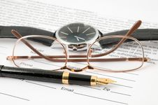 Free Eyeglasses And Pen And Wristwatch Royalty Free Stock Images - 22248819