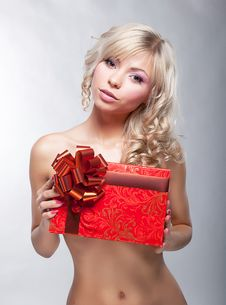 Sensual Blonde Girl With Red Gift Box Royalty Free Stock Photography
