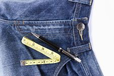 Free Measuring Tape On Front Blue Jeans Royalty Free Stock Images - 22255319