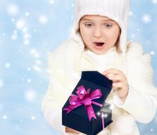 Little Girl In Cap Opens The Box Stock Image