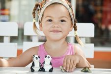 Free A Girl Playing With Toy Pandas At The Table Royalty Free Stock Photos - 22270998